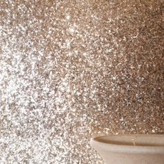 Glitter wallpaper - this could be cute as an accent wall in a bathroom. (Or as accent stripe)