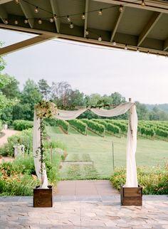 Outdoor vineyard wedding ceremony, romantic arbor, cream and pink florals // Sera Petras Photography