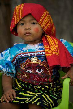 Little Kuna girl with mola, Panama
