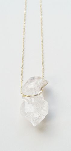 This piece is as absolutely stunning.  Featuring a beautiful natural Double Herkimer Diamond mineral gemstone which was hand crafted into a 14k gold filled lariat pendant.  This necklace highlights the beautiful glowing crystal elements of this arresting stone. The stone measures approx. 1/2 (1-1.5cm) long.  This stone is a remarkable feature of nature and hangs from 18 14k gold filled chain. This piece is a limited piece edition so get it while it lasts. Please note the photo i took was…