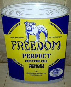 Die-cut sign in the shape of the company's can of motor oil showing a dog top center.