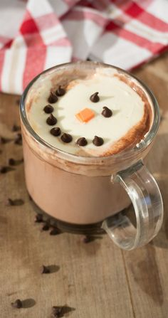 Jazz up your hot chocolate with these whipped cream snowmen.