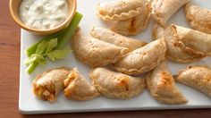 bite-size empanadas filled with a spicy Buffalo chicken filling! Serve with blue cheese dressing and celery