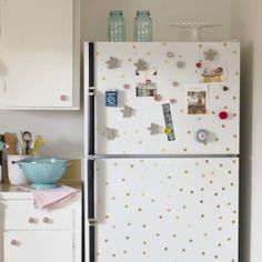 Tired of your boring rental fridge? Give it an update with circles punched out of gold contact paper. They'll peel right off when you move!