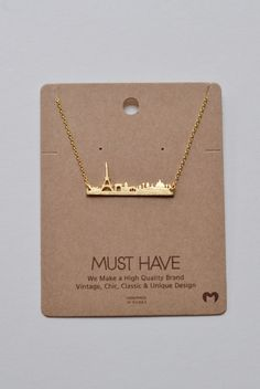 An adorable bar-like necklace showing the Paris skyline. Can you say amour?! - Length: approx. 16 inches.