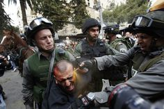 Israeli border police officers use pepper spray as they detain an injured Palestinian protester during clashes on Land Day after Friday prayers outside Damascus Gate in Jerusalem's Old City, March 30 (Photo by Ammar Awad/Reuters) Elie Wiesel, Weekender, Fotojournalismus, Tahrir Square, Blog Fotografia, World Press, United We Stand, Powerful Images, Press Photo