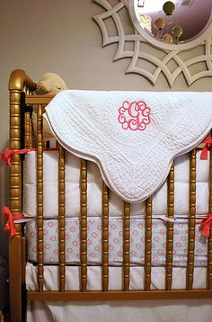 gold crib, white linens, mirror, monogram! perfect!