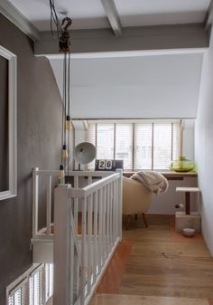 The second floor landing features a snug little study that also doubles as the cats' hangout.