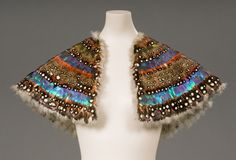 Pelerine. c.1830 decorated with rows of feathers and lined with what might be swan-skin, with the down attached.