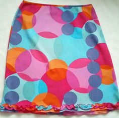 "The Limited size 12 multicolor circles skirt EUC. The Limited bright colorful ightweight size 12 skirt with a narrow ruffle at the bottom. 100% stretch Polyester that has a crepe like feel and texture. Unlined. Skirt is 23"" long. Waist is 32"" but has a stretch to 34"". Hips are about 42"" with a stretch to 46"". Side zipper and hook closure. EUC. Smoke free pet friendly home. One day delivery. The Limited Skirts A-Line or Full"