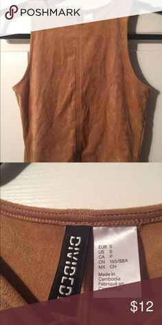 H&M suede crop top Never been worn. Too tight on me but super cute! In perfect condition (it's just wrinkly in this pic) H&M Tops Crop Tops