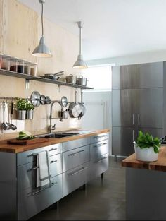 Ikea Stainless [OK I just noticed that the back wall is plywood AND if you look closely they have clear glass as a back splash. Could this be any more dreamy?]