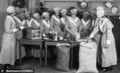 Young women in 1918 learn how to make pies at the YWCA