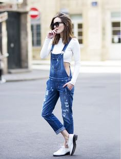 White crop top, denim overalls, white shoes, and sunglasses