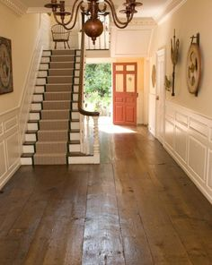Federal style hallway with painted wainscoting, wide pine floors