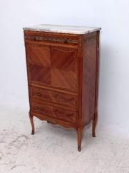 Antique French style marble top drinks cabinet that has the look of an secretaire, with the pull down front. There is a mirror inside on the back & it has a glass shelf that as you can see is laying on the bottom inside. It has a drawer on top with two more at the bottom & it sits on shaped French feet.
