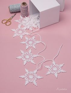 Snowflake crochet motif nr 4 pattern by Anabelia Craft DesignCrochet Snowflakes garlands for Christmas made in lace thread.Lacy Joyful Tree Topper free crochet pattern in Aunt Lydia's Crochet Thread - SalvabraniLovely Christmas tree decoration with e Crochet Snowflake Pattern, Crochet Garland, Crochet Stars, Crochet Snowflakes, Crochet Motifs, Crochet Doilies, Crochet Flowers, Crochet Patterns, Thread Crochet