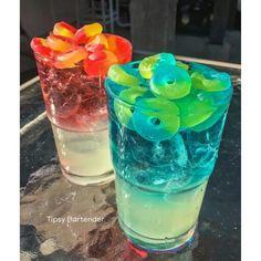 ELECTRIC BLUE TYPHOON Top Layer: 1 oz. UV Blue Vodka 1/2 oz. Island Punch Pucker 1 1/2 oz. Lemon Lime Soda Bottom Layer: 1/2 oz. Simple Strup 2 oz. Lemonade 1/2 oz. Blueberry Lemonade Rum Lifesaver Gummies Collisions SWEET COLLISION Top Layer: 1 oz. UV Cherry Vodka 1/2 oz. Strawberry Liqueur 1 1/2 oz. Lemon Lime Soda Bottom Layer: 1/2 oz. Simple Syrup 2 oz. Lemonade 1/2 oz. Blueberry Lemonade Rum Lifesavers Gummies Collision