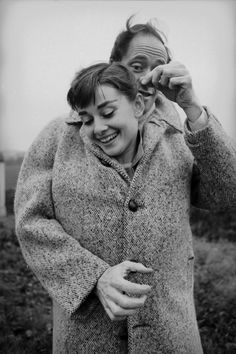 Audrey Hepburn and Mel Ferrer sharing a coat