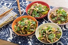 Sweet & Sour Stir-Fried Beef with Udon Noodles, Long Beans & Bok Choy - 1¼ Pounds Stir-Fry Cut Beef 1 Pound Fresh Udon Noodles 3 Scallions 2 Cloves Garlic 1 Pound Bok Choy ½ Pound Long Beans 1 Bunch Cilantro  3 Tablespoons Peanuts 1 1-Inch Piece Ginger ½ Cup Soy Glaze ¼ Cup Rice Vinegar