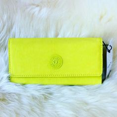 29✂Kipling Trifold Lime Green Wallet PRICE IS FIRM (Seeon TITLE) Make me an offer, it's YOURS! ➖➖➖  ✨NWT, but not attached Got torn off when I was taking picture   ⏩Beautiful lime green, so hard to capture how stunning the color is! ⏩Super cute, perfect for spring picnic! ⏩Adjustable snap closure ⏩Interior   ➖2 mesh windows for ID, 3 multi-use compartments, 1 zip compartment   ➖13 card pockets in different sizes, 2 compartments ⏩So many pockets! ❤ Highly functional, chic, stylish…