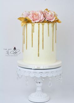 """Gold Drip Cake.  All champagne buttercream on this Pink Champagne Bridal Shower cake! 11"""" tall, hand painted chocolate drip.  Topped with fondant roses in various shades of pink and gold. www.TheArtInCake.com"""