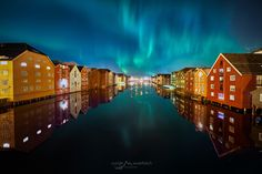 Aurora Trondheim - A first image of this really crazy northern lights storm last wednesday night. The dancing lights were so impressive and beautiful that in the end I was not even feeling the freezing cold during this 3 hours of being on the old town bridge of Trondheim. I am very happy that I got this image as with another photographer we were discussing and imagining exactly such northern lights over the channel with a reflection, and voila 1 week later this happend.  Check out my other… Freezing Cold, Trondheim, One Image, Old Town, Aurora, Wednesday, Reflection, Northern Lights, Dancing