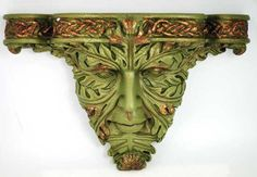 A wonderful accent for your home or sacred space, this wall piece stylizes the ancient image of the Greenman as a wall bracket to accent your home or sacred space. With vivid attention to detail the piece has been sculpted from cold cast resin to form the leafy features of the Greenman as though they were sculpted from aged copper. The result is a hauntingly beautiful image of eyes that could be almost sad, framed as they are in leafy lashes and vine-filled facial hair, all appearing a…