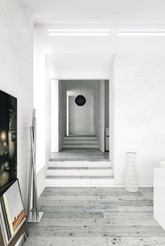 Nice combinationof white walls and greyish wooden floor.
