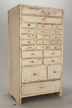 Small pine apothocary chest in original white paint. 24 drawers in assorted sizes, having nailed construction; top drawer is divided into sections.