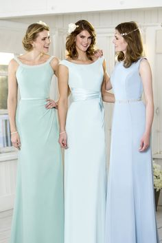 M706- This elegant chiffon bridesmaid dress featuring a flattering pearl encrusted neckline and is designed with our signature figure flattering skirt silhouette. A zip up back is finished with buttons. Pictured here in Aqua.