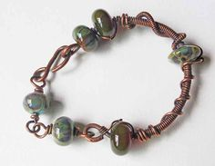 Wire wrapped antiqued copper and lampwork bead by ColganDesigns
