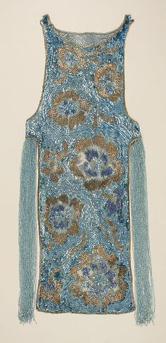 Evening dressDesign House: House of Worth (French, 1858–1956) Date: ca. 1924 Culture: French Medium: cotton, plastic, glass Dimensions: Length at CB: 42 in. (106.7 cm) Credit Line: Gift of Mary Michael Gifford, 1981