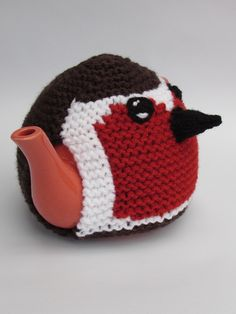 The Three Birds tea cosy from the TeaCosyFolk range of tea cosies has bags of character. You can buy the Three Birds tea cosy as a finished hand crafted tea cosy , or as a Three Birds tea cosy knitting pattern to make your own tea cosy with character Tea Cosy Knitting Pattern, Tea Cosy Pattern, Knitting Patterns, Knitted Tea Cosies, Knitting For Charity, Loom Knitting Projects, Fabric Yarn, Tea Cozy, Christmas Tea