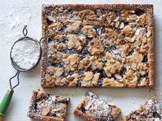 Raspberry Crumble Bars : Ina bakes basic shortbread with raspberry jam for an unmatchable dessert crumble.