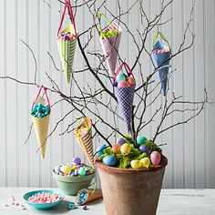 Display Easter sweets and treats with this nature-inspired candy tree. A terra-cotta pot, some florist foam, and scrapbook materials will have little ones thinking candy does grow on trees. See the Step-by-Step GuideSee More: 10 Fail-Proof Easter Crafts Easter Tree, Easter Eggs, Homemade Easter Baskets, Candy Trees, Easy Easter Crafts, Diy Crafts, Easter Table Decorations, Easter Candy, Easter Celebration