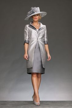 Knee length dress with round neck and wide straps. The dress is complete with a beaded detail around the waist. The coat has elbow length sleeves with a double collar and closes with diamante clasp. Product Code: 427750/407981 Colour: Silver/Grey
