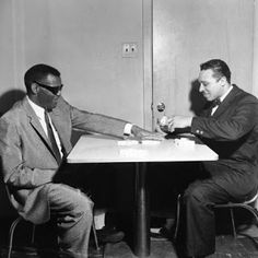 Ray Charles playing dominoes with Chicago's Tivoli night club owner Herman Roberts (1961). Photo by David Jackson.