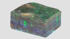 This exceptionally large 1.43 kg block of opal, which measures 12.8 × 10.1 × 5.8 cm, is rare not only for its size but also its oolitic texture. Photo by C. D. Mengason/GIA, courtesy of Tibor Shelley/Opals by GMT. GIA (051414)