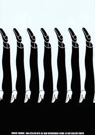 This picture illustrates figure ground the negative spaces look like male legs and female legs.