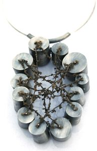 Karen Gilbert - sterling silver, stainless steel, spun fishing net