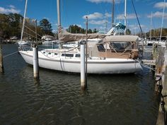 """1986 Catalina 34' """"Sail Away"""" - With great features such as full cockpit enclosure and conditioned air, this Catalina 34 is ready to enjoy. Her decks feel solid underfoot and her rigging appears to be in good condition. The engine starts easily and runs well will no hesitation while underway. Her sails have some age on them but are serviceable and easy to handle. Price $31,000"""