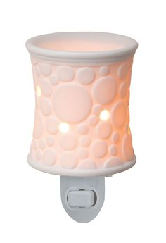 Fizz Plug-In Scentsy Warmer A cool, modern design of circles on bone-finish porcelain. Glows from within when lit.