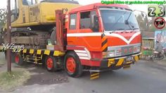 Fuso Self Loader Volvo UD Trucks Transporting Excavator And ...