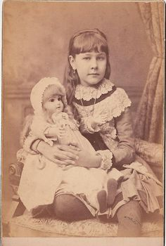 Girl with Jumeau doll  American image, circa 1885. Girl with Jumeau doll
