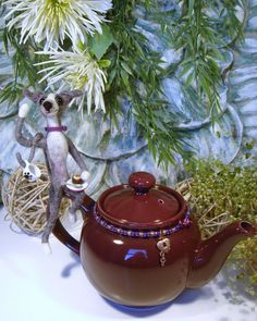 This is my Trademark copyrighted needle felted Greyhound teapot. Made by Sue Ann Schley. Check out my Esty Shop: SamsFurKids: https://www.etsy.com/shop/SamsFurKids?page=1