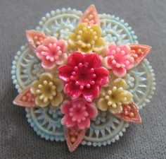 Vintage Celluloid Flower Pin. Originally pinned by Colleen Abbott (colleen466)