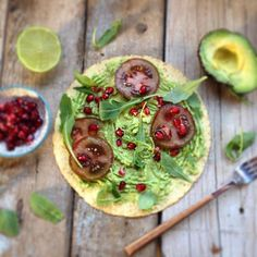 My favourite! Saturday morning smashed avocado with beautiful red/black tomatoes, pomegranate seed and rocket