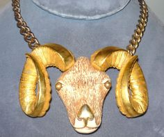 insanely huge rams head necklace.