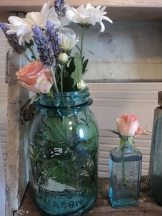 aqua mason jar. Nice, simple flower arrangement